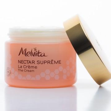 Pot crème Melvita laqué couleur saumon + décor encre + couvercle doré